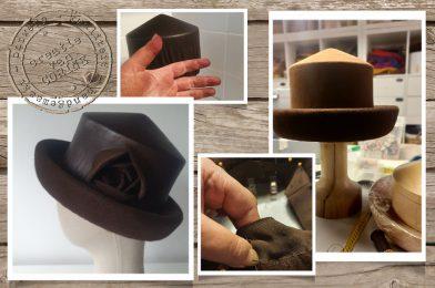 hoed met leer